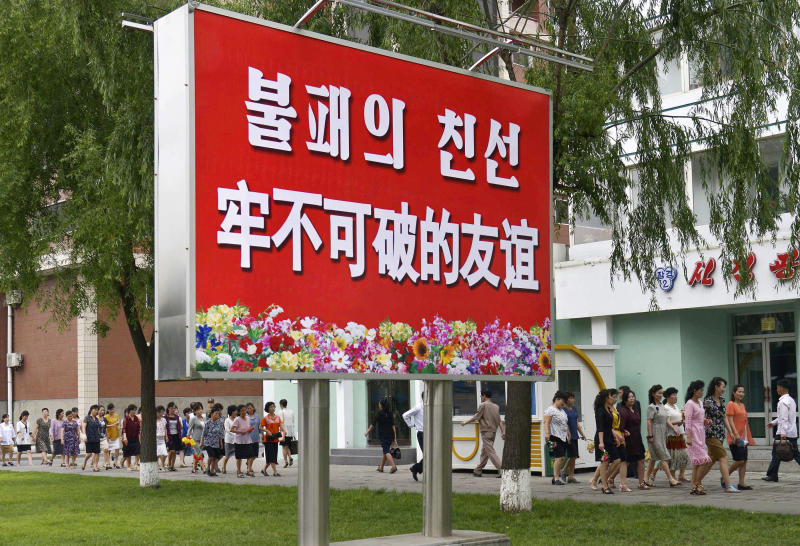 """The signboard, which reads """"Unbreakable friendship"""" in Chinese and Korean language respectively, is displayed in Pyongyang, North Korea, Thursday, June 20, 2019.  The leaders of China and North Korea were talking in the North Korean capital Thursday, with stalled nuclear negotiations with Washington expected to be on the agenda.(Kyodo News via AP)"""