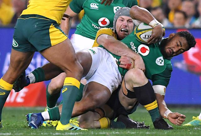 Rugby Union - June Internationals - Australia vs Ireland - Sydney Football Stadium, Sydney, Australia - June 23, 2018 - Bundee Aki of Ireland is tackled by David Pocock of Australia. AAP/David Moir/via REUTERS ATTENTION EDITORS - THIS IMAGE WAS PROVIDED BY A THIRD PARTY. NO RESALES. NO ARCHIVE. AUSTRALIA OUT. NEW ZEALAND OUT.