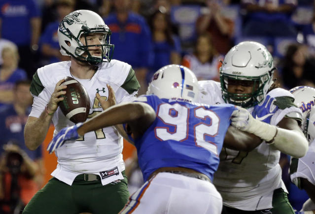 UAB quarterback A.J. Erdely, left, looks for a receiver as he is pressured by Florida defensive lineman Jabari Zuniga (92) during the second half of an NCAA college football game, Saturday, Nov. 18, 2017, in Gainesville, Fla. (AP Photo/John Raoux)