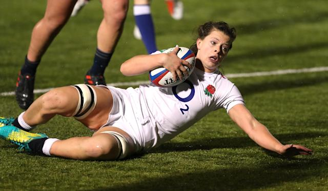 England's Abbie Scott scores their fourth try Action Images/Peter Cziborra