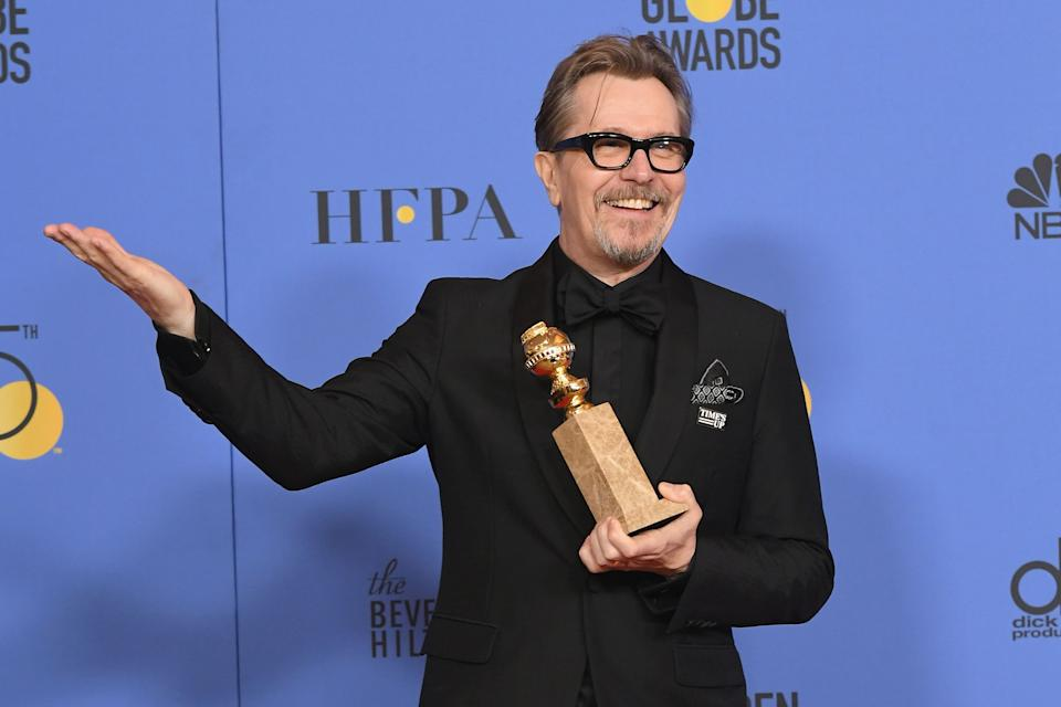 "Gary Oldman posing with his Golden Globe for Best Actor in ""Darkest Hour"" in 2018. Four years previously, he had said the HFPA were ""90 nobodies having a wank."" (Photo: Kevin Winter / Staff)"