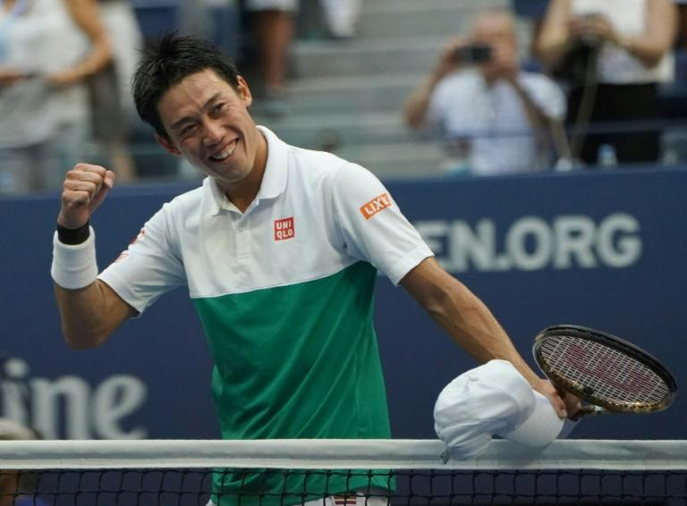 On the upswing: Kei Nishikori celebrates his US Open quarter-final victory over Marin Cilic