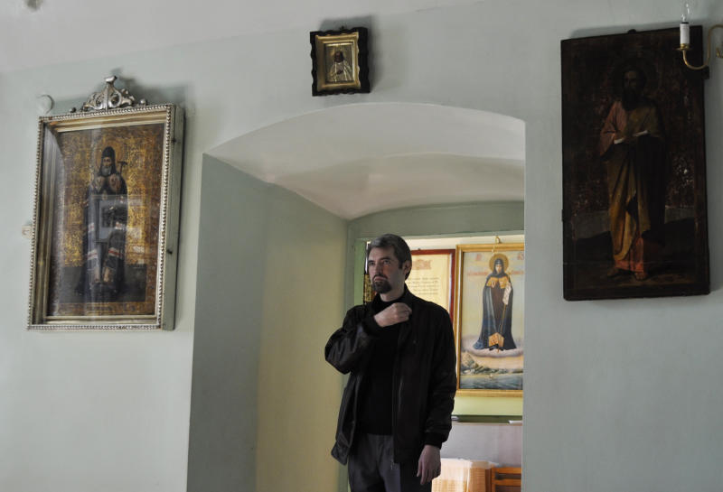 Deacon Sergei Baranov prays in a church in Tambov, Russia, on Tuesday, Sept. 18, 2012. Deacon Sergei Baranov from Tambov became the first Russian Orthodox cleric to have walked out in protest over the church's treatment of the Pussy Riot case. Baranov, defrocked at his request, told the Associated Press in an interview, that he supports the band's stunt and does not regret his resignation. (AP Photo/Laura Mills)