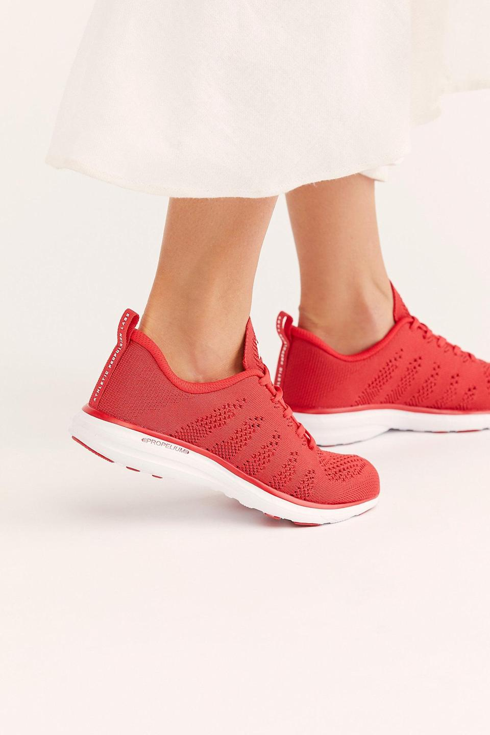 """<p>Get these <a href=""""https://www.popsugar.com/buy/APL-Techloom-Pro-Trainers-527146?p_name=APL%20Techloom%20Pro%20Trainers&retailer=freepeople.com&pid=527146&price=140&evar1=fab%3Aus&evar9=45460327&evar98=https%3A%2F%2Fwww.popsugar.com%2Ffashion%2Fphoto-gallery%2F45460327%2Fimage%2F46977996%2FAPL-Techloom-Pro-Trainers&list1=shopping%2Cgifts%2Cfree%20people%2Choliday%2Cgift%20guide%2Cgifts%20for%20women&prop13=api&pdata=1"""" class=""""link rapid-noclick-resp"""" rel=""""nofollow noopener"""" target=""""_blank"""" data-ylk=""""slk:APL Techloom Pro Trainers"""">APL Techloom Pro Trainers</a> ($140) for the runner in your life.</p>"""