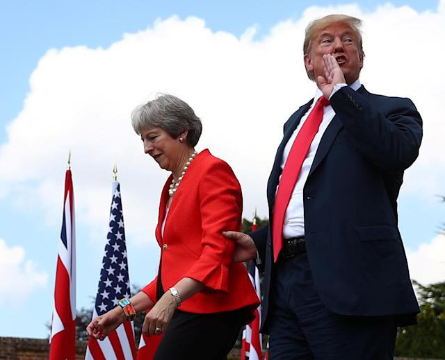 <p>Britain's Prime Minister Theresa May and President Donald Trump walk away after holding a joint news conference at Chequers, the official country residence of the Prime Minister, near Aylesbury, Britain, July 13, 2018. (Photo: Hannah McKay/Reuters) </p>