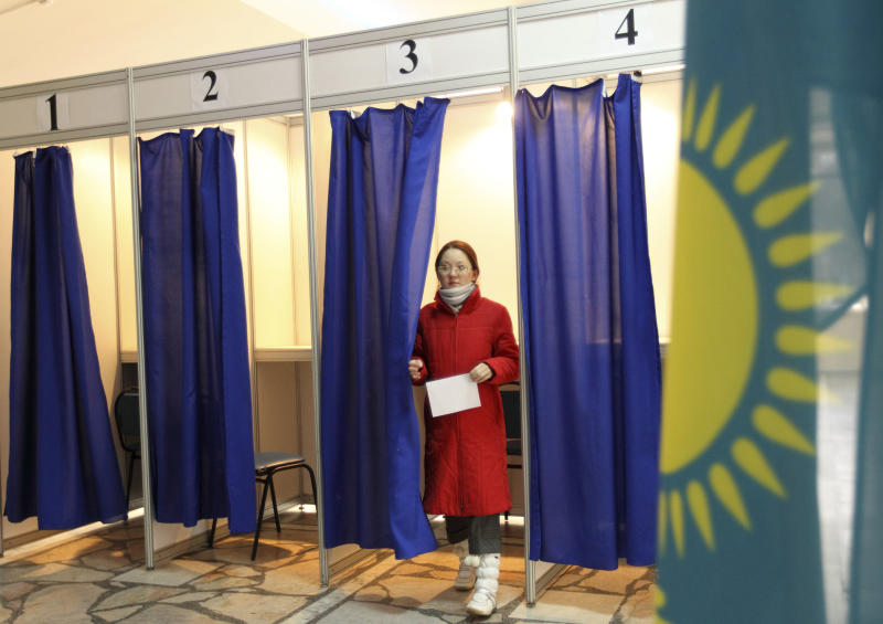 A Kazakh woman leaves a voting booth during the Kazakh presidential election at a polling station in Almaty, Kazakhstan, Sunday, April 3, 2011. Voters in Kazakhstan cast their ballots Sunday in a election that is expected to overwhelmingly renew long-serving President Nursultan Nazarbayev's grip on power. (AP Photo/Nikita Bassov)