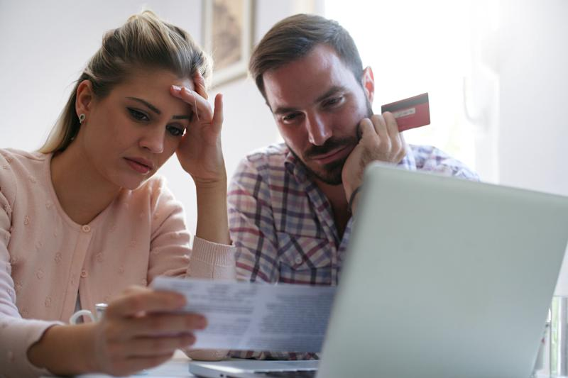Couple having problem with bills and money. (Photo: Liderina via Getty Images)