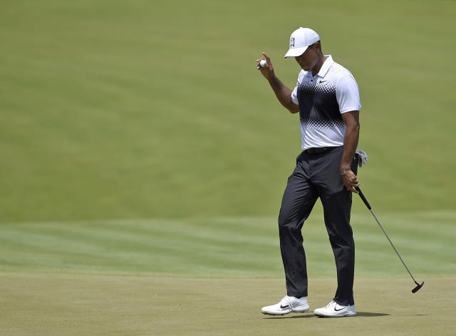 Tiger Woods is in contention at the Quicken Loans National and is making impossible shots look easy again. (AP Photo)