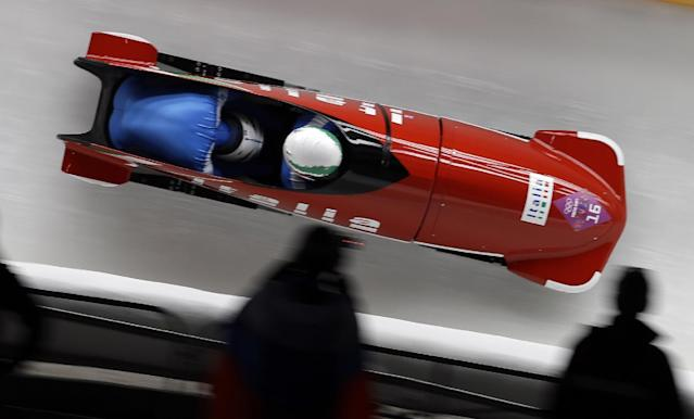 The team from Italy ITA-1, piloted by Simone Bertazzo and brakeman Simone Fontana, take turn five during the men's two-man bobsled competition at the 2014 Winter Olympics, Sunday, Feb. 16, 2014, in Krasnaya Polyana, Russia. (AP Photo/Natacha Pisarenko)