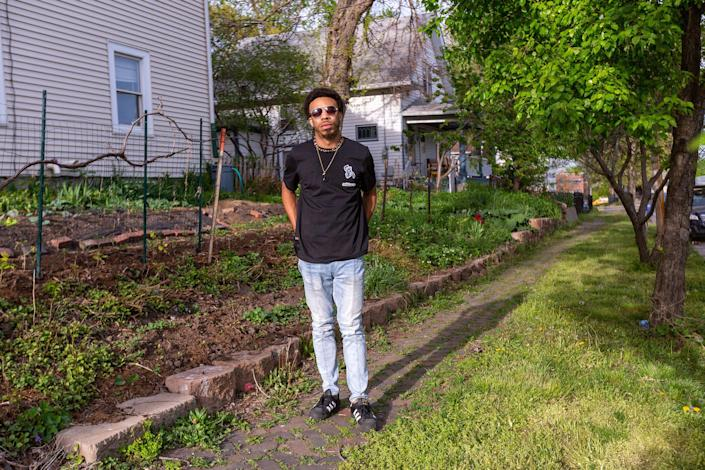 Image: Mate Muhammad in the garden of the house where he lives in Des Moines, Iowa on April 30, 2021. (Rachel Mummey / for NBC News)