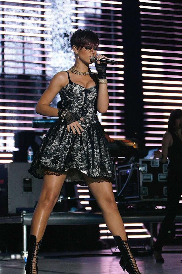 "Rihanna sports an '80s-inspired prom dress and black lace gloves for her sexy solo. Soul Brother/<a href=""http://www.filmmagic.com/"" target=""new"">FilmMagic.com</a> - July 4, 2008"