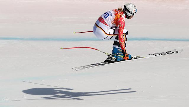 Germany's Maria Hoefl-Riesch jumps during the downhill portion of the women's supercombined at the Sochi 2014 Winter Olympics, Monday, Feb. 10, 2014, in Krasnaya Polyana, Russia. (AP Photo/Alessandro Trovati)