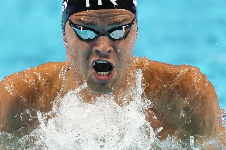Michael Andrew participates in the men's 100 breaststroke during wave 2 of the U.S. Olympic Swim Trials on Sunday, June 13, 2021, in Omaha, Neb. (AP Photo/Charlie Neibergall)