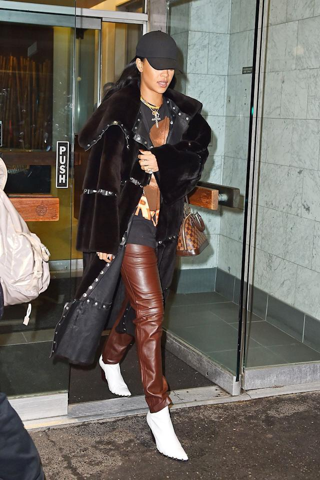 <p>Sporting layered brown leathers, white boots and a black baseball cap in SoHo, NYC</p>