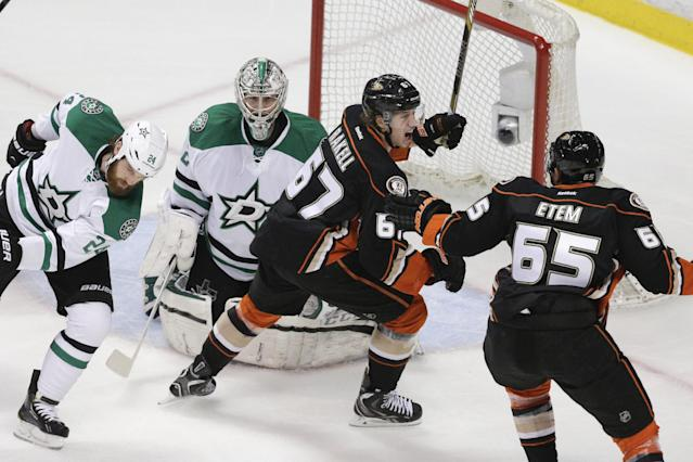 Anaheim Ducks' Rickard Rakell (67), of Sweden, and Emerson Etem(65) celebrate Rakell's goal in front of Dallas Stars goalie Kari Lehtonen(32) and Jordie Benn (24) in the first period of Game 5 of the first-round NHL hockey Stanley Cup playoff series on Friday, April 25, 2014, in Anaheim, Calif. (AP Photo/Jae C. Hong)