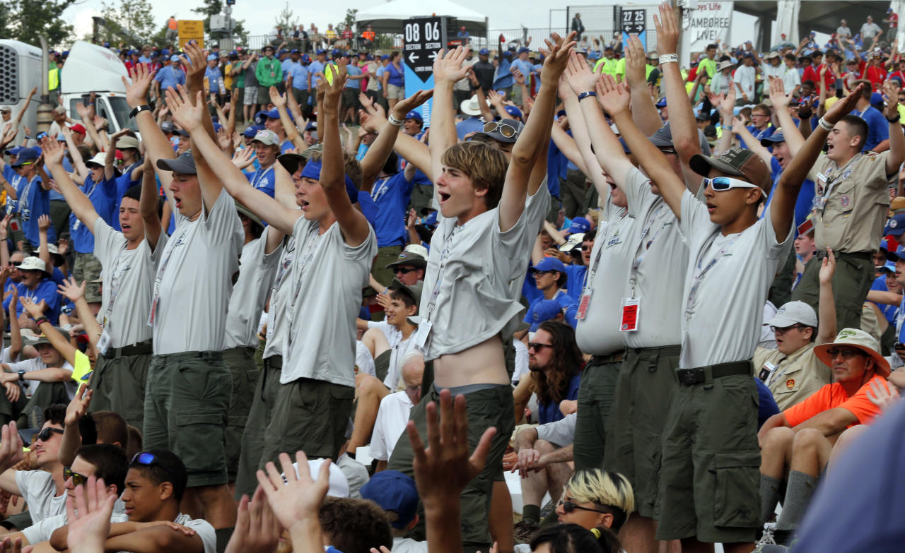 Boy Scouts sing and dance to music as they await the arrival of President Donald Trump at the 2017 National Boy Scout Jamboree at the Summit in Glen Jean, W.Va., Monday, July 24, 2017. (AP Photo/Steve Helber)