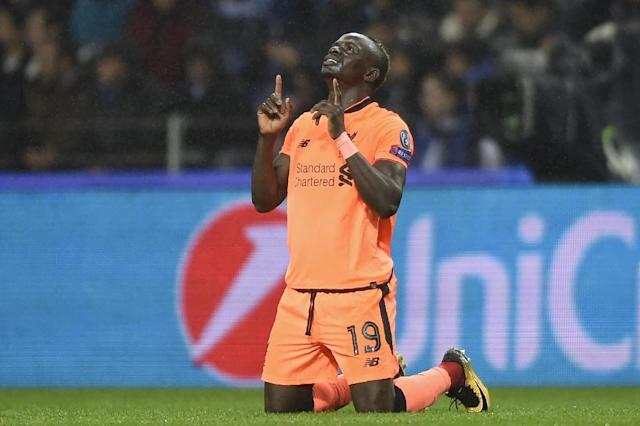 Liverpool's midfielder Sadio Mane celebrates after scoring the opening goal against Porto, Portugal (AFP Photo/MIGUEL RIOPA )