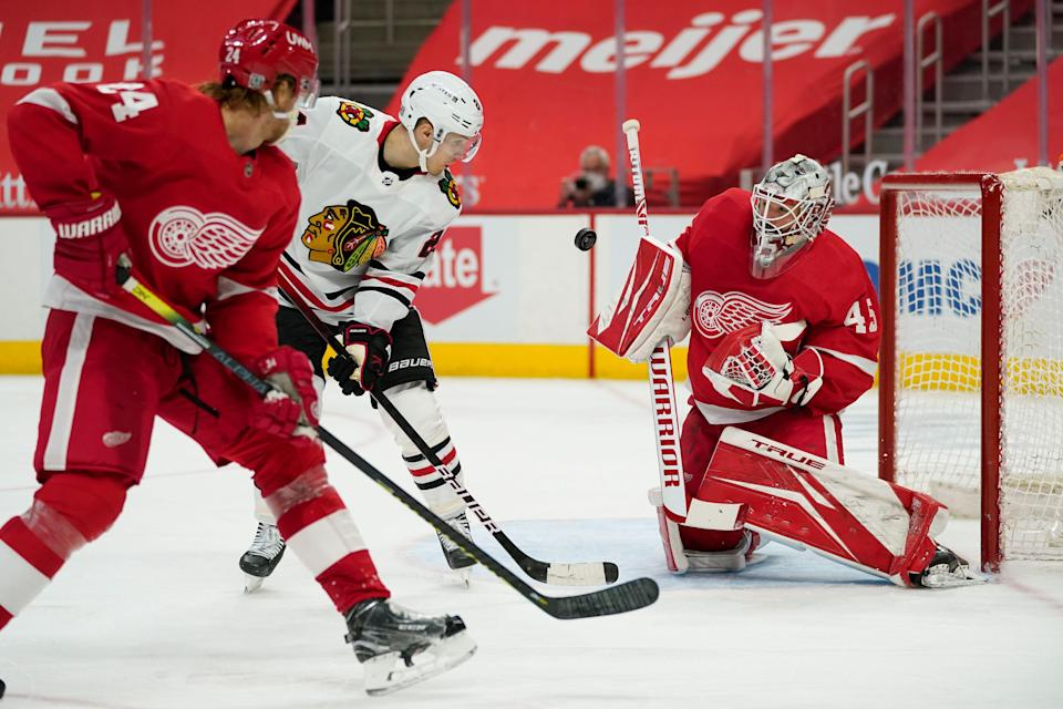 Detroit Red Wings goaltender Jonathan Bernier stops a shot by Chicago Blackhawks center Pius Suter in the third period Wednesday, Feb. 17, 2021 at Little Caesars Arena.