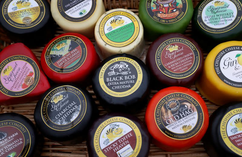 Individually wrapped cheeses from the Cheshire Cheese company are displayed in a tray at Hartington Creamery near Matlock