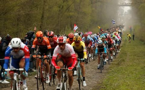 <span>The main bunch passes through the Trouée d'Arenberg</span> <span>Credit: EPA </span>