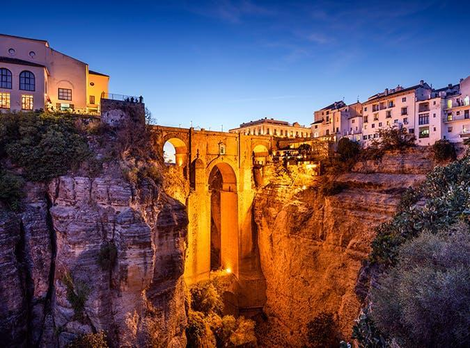 """<p>This Andalucían city stands atop El Tajo gorge, which the Guadalevín River flows through. A jaw-dropping bridge connects the 15th-century """"new"""" town from the old city that dates back to Moorish rule.</p>"""