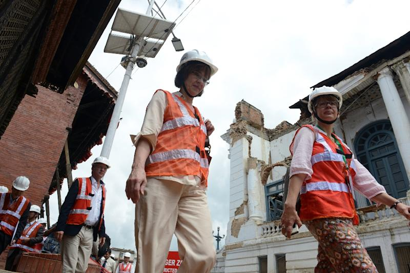 Foreign delegates visit reconstruction at a damaged area of Durbar Square ahead of the International Conference on Nepal Reconstruction in Kathmandu on June 24, 2015 (AFP Photo/Prakash Mathema)
