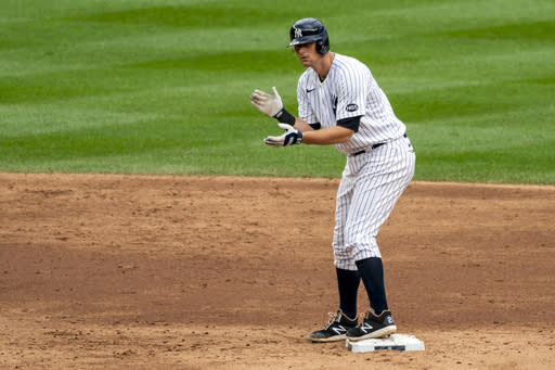 New York Yankees' DJ LeMahieu celebrates at second base after hitting a two-run double during the sixth inning of a baseball game against the Florida Marlins at Yankee Stadium, Saturday, Sept. 26, 2020, in New York. (AP Photo/Corey Sipkin)