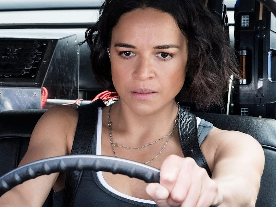 """Nathalie Emmanuel's Ramsey looking at Michelle Rodriguez's Letty behind the wheel of a vehicle in """"Fast and Furious 9."""""""