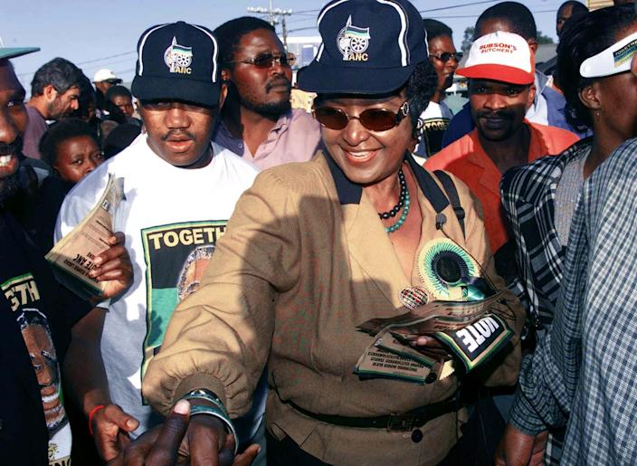 <p>Winnie Madikizela-Mandela meets voters during a tour in Flagstaff, South Africa, on May 20, 1999. Deputy President Thabo Mbeki, the most likely presidential candidate to succeed retiring President Nelson Mandela, said Thursday there would be no repeat of the violence that marred the first democratic election in 1994 when black and white South Africans vote together for the second time on June 2. (Photo: Juda Ngwenya/Reuters) </p>