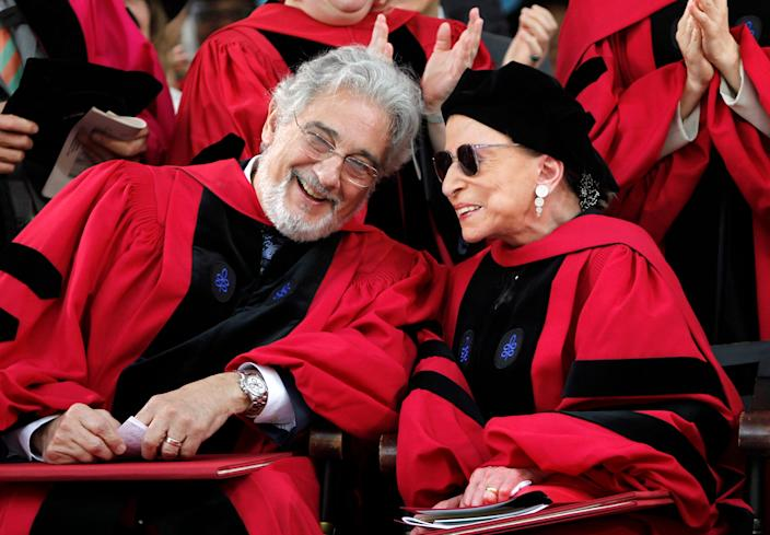 Opera tenor Placido Domingo, left, chats with Supreme Court Justice Ruth Bader Ginsburg, right, during Harvard University's 360th commencement exercises, on the school's campus, in Cambridge, Mass., Thursday, May 26, 2011.