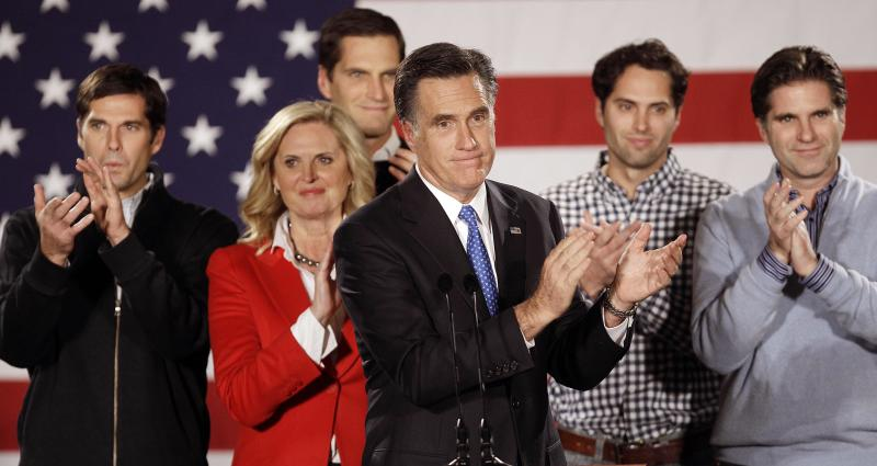 FILE -- In a Jan. 3, 2012 file photo Republican presidential candidate, former Massachusetts Gov. Mitt Romney applauds after addressing a crowd of supporters with his wife Ann and their sons Matt, Josh, Craig and Tagg behind him during a Romney for President Iowa Caucus night rally in Des Moines, Iowa.  During what may be the most important week of Mitt Romney's political career, the Republican presidential contender's five sons are sharing family secrets like never before.  (AP Photo/Charlie Neibergall, file)