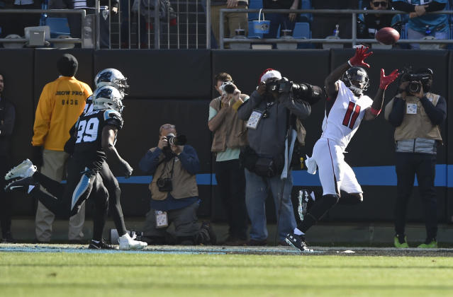 Atlanta Falcons' Julio Jones (11) catches a touchdown pass past Carolina Panthers' Mike Adams (29) during the first half of an NFL football game in Charlotte, N.C., Sunday, Dec. 23, 2018. (AP Photo/Mike McCarn)
