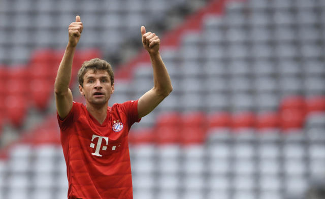 Munich's Thomas Mueller gestures during the German Bundesliga soccer match between FC Bayern Munich and Fortuna Duesseldorf in Munich, Germany, Saturday, May 30, 2020. Because of the coronavirus outbreak all soccer matches of the German Bundesliga take place without spectators. (Christof Stache/Pool via AP)