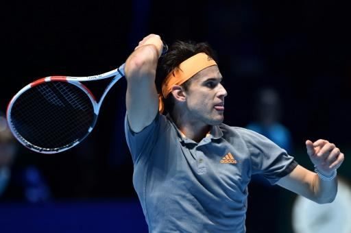 Dominic Thiem in action against Novak Djokovic during their round-robin match at the ATP Finals