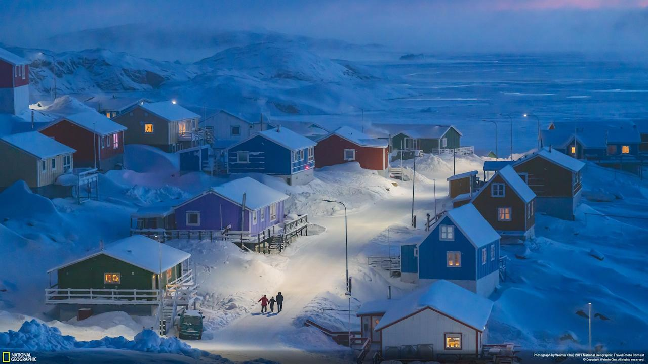 Weimin Chu won the National Geographic Photo Contest with 'Greenlandic Winter', showing the fishing village of Upernavik and its coloured buildings. [Picture: National Geographic Travel Photo Contest]