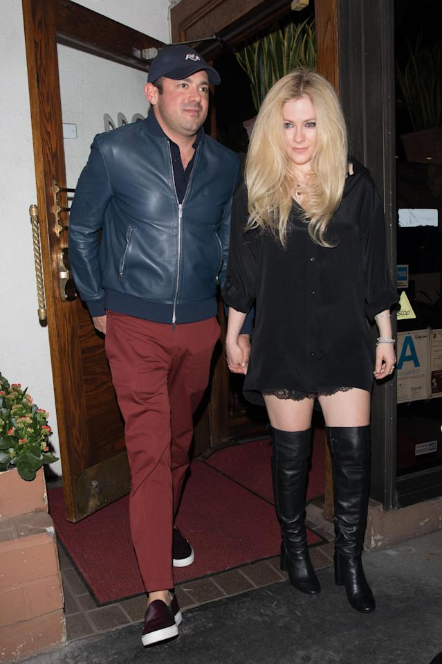 Avril Lavigne is seen leaving Madeo Ristorante in West Hollywood, Calif., holding hands with Phillip Sarofim in March. (Photo: Mr.Canon/Splash News)