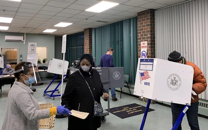 People vote in the 2020 general elections at a polling station in Manhattan - TASS