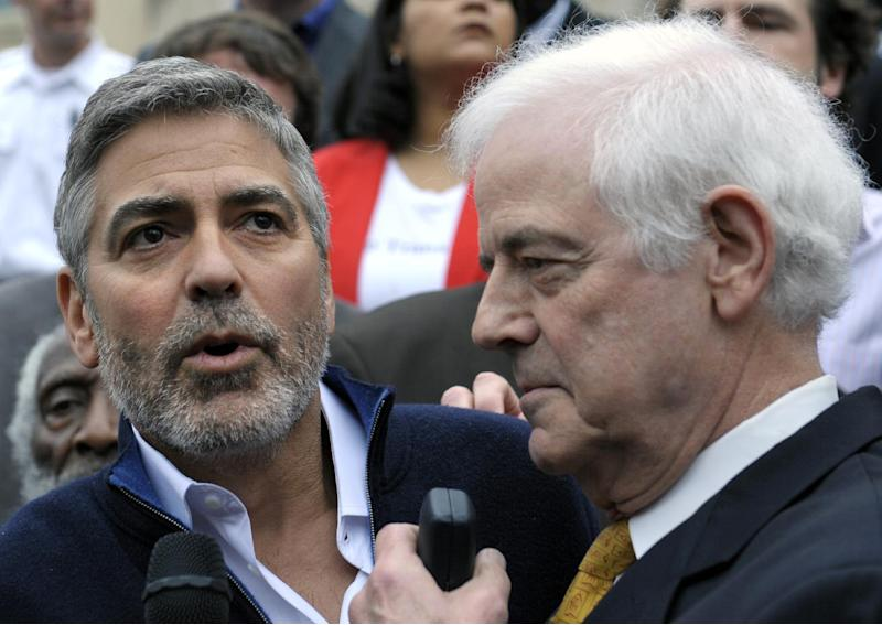 Actor George Clooney, and his father Nick Clooney, take part in a protest at the Sudan Embassy in Washington, Friday, March 16, 2012. The demonstrators are protesting the escalating humanitarian emergency in Sudan that threatens the lives of 500,000 people. (AP Photo/Cliff Owen)