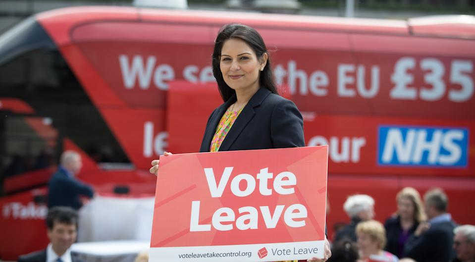 PORTSMOUTH, ENGLAND - MAY 13: Conservative MP and Minister of State for Employment, Priti Patel holds a Vote Leave poster as she joins the Vote Leave battle bus tour as it stops in Portsmouth on May 13, 2016 in Portsmouth, England. Portsmouth City Council members voted in March in favour of a motion declaring that the UK would be better off outside the EU declaring that Portsmouth should vote to leave the EU in the referendum to be held on Thursday June 23. (Photo by Matt Cardy/Getty Images)