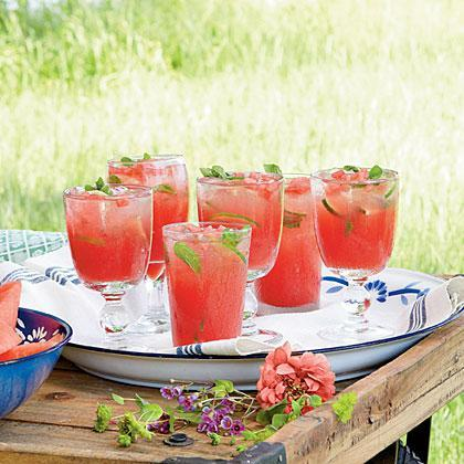 """<p><strong>Recipe: <a href=""""https://www.southernliving.com/syndication/honeysuckle-watermelon-cocktails"""" rel=""""nofollow noopener"""" target=""""_blank"""" data-ylk=""""slk:Honeysuckle Watermelon Cocktail"""" class=""""link rapid-noclick-resp"""">Honeysuckle Watermelon Cocktail</a></strong></p> <p>Honeysuckle and watermelon are two signs of summer in the South so we combined them both into one sweet cocktail. </p>"""