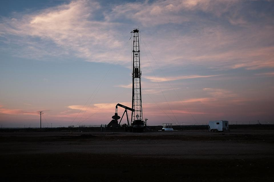 MIDLAND, TX - FEBRUARY 05: An oil drill is viewed near a construction site for homes and office buildings on February 5, 2015 in Midland, Texas. As crude oil prices have fallen nearly 60 percent globally, American communities dependent on oil revenue prepare for hard times. Texas, which benefited from hydraulic fracturing and the shale drilling revolution, tripled its production of oil in the last five years. The Texan economy saw hundreds of billions of dollars come into the state before the global plunge in prices. Across the state drilling budgets are being slashed and companies are notifying workers of upcoming layoffs. According to federal labor statistics, around 300,000 people work in the Texas oil and gas industry, 50 percent more than four years ago. (Photo by Spencer Platt/Getty Images)