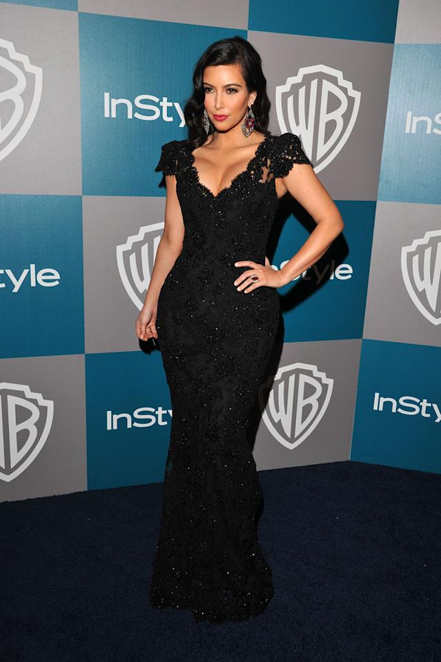 """<p class=""""MsoNormal""""><span style=""""font-family:Arial;"""">Kim Kardashian was dissed by Golden Globes host Ricky Gervais less than three minutes into Sunday night's telecast, but that didn't stop the reality TV star from putting on a brave face and hitting the multitude of after parties. The recently divorced vixen -- who shrugged off Gervais' <a target=""""_blank"""" href=""""http://omg.yahoo.com/blogs/golden-globes/ricky-gervais-targets-kim-kardashian-023611861.html"""">racy remarks</a> by telling E!, """"I thought it [the show] was funny"""" -- turned heads in a beaded, black lace Bruce Oldfield frock and frothy curls upon arriving at the 13th Annual Warner Bros. and InStyle soiree.</span></p>"""