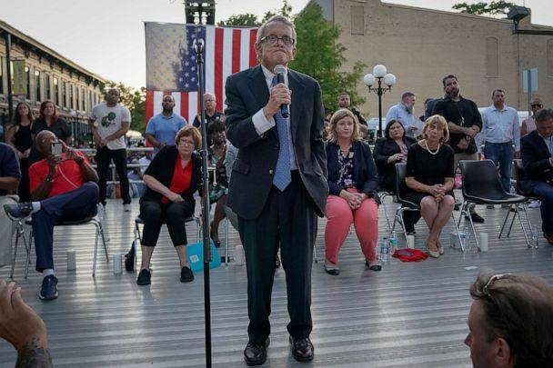 PHOTO: Ohio Governor Mike DeWine reacts as vigil attendees shout, 'Do Something' while he was speaking at a vigil at the scene after a mass shooting in Dayton, Ohio, Aug. 4, 2019. (Bryan Woolston/Reuters)
