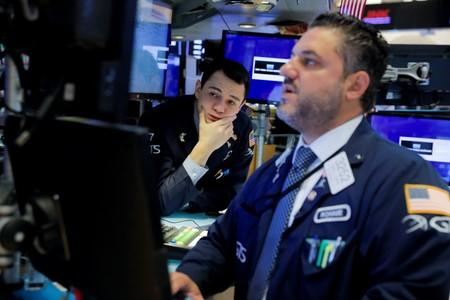 Traders work on the trading floor at the New York Stock Exchange (NYSE) in New York City