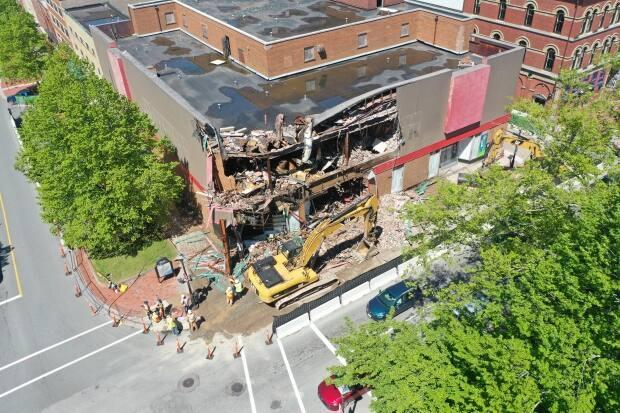Demolition of the former Woolworth's building in Saint John could take more than a week. (Shane Fowler/CBC News - image credit)