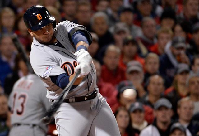 Oct 13, 2013; Boston, MA, USA; Detroit Tigers outfielder Jhonny Peralta (27) hits a single against the Boston Red Sox during the second inning in game two of the American League Championship Series baseball game at Fenway Park. (Robert Deutsch-USA TODAY Sports)