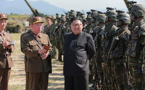 "As North Korean dictator Kim Jong-un boasts of his military prowess and flaunts his high tech weapons to the world, his malnourished soldiers are said to be stealing corn from fields to stave off hunger pangs. Officers are ordering their troops to supplement their meagre food rations by plundering local fields, in order to keep up their strength for battle, according to a report in the Daily NK. ""The military officers are instructing their soldiers, exhausted after training, to eat corn in the fields because war is imminent,"" a source in North Hamgyong Province told the news website. Inside North Korea ""They are even threatening their soldiers, saying: if you become malnourished despite permission to eat the corn, you will face difficulties."" Another source in Ryanggang Province claimed that soldiers carrying big sacks of unripened corn had frequently been spotted trying to sell their wares at markets. The desperate conditions of his army paints a stark contrast with Mr Kim's brash threats since he fired a ballistic missile over Japan on Tuesday. North Korean leader Kim Jong-un presides over a target strike exercise conducted by the special operation forces of the Korean People's Army  Credit: AFP On Wednesday he hailed the test as a ""good experience in…rocket operation for an actual war"" and as a ""meaningful prelude to containing"" Guam, the US Pacific territory he threatened with missile strikes earlier this month. North Korean citizens, some of whom now have to guard their fields from marauding troops, are reported to be unimpressed by his bravado. ""An increasing number of residents are pointing out that, for them, provoking the US is a losing battle,"" the Daily NK reported. Korean People's Army (KPA) soldiers applaud as they watch a screen showing the missile test launch, in Pyongyang  Credit: AFP"