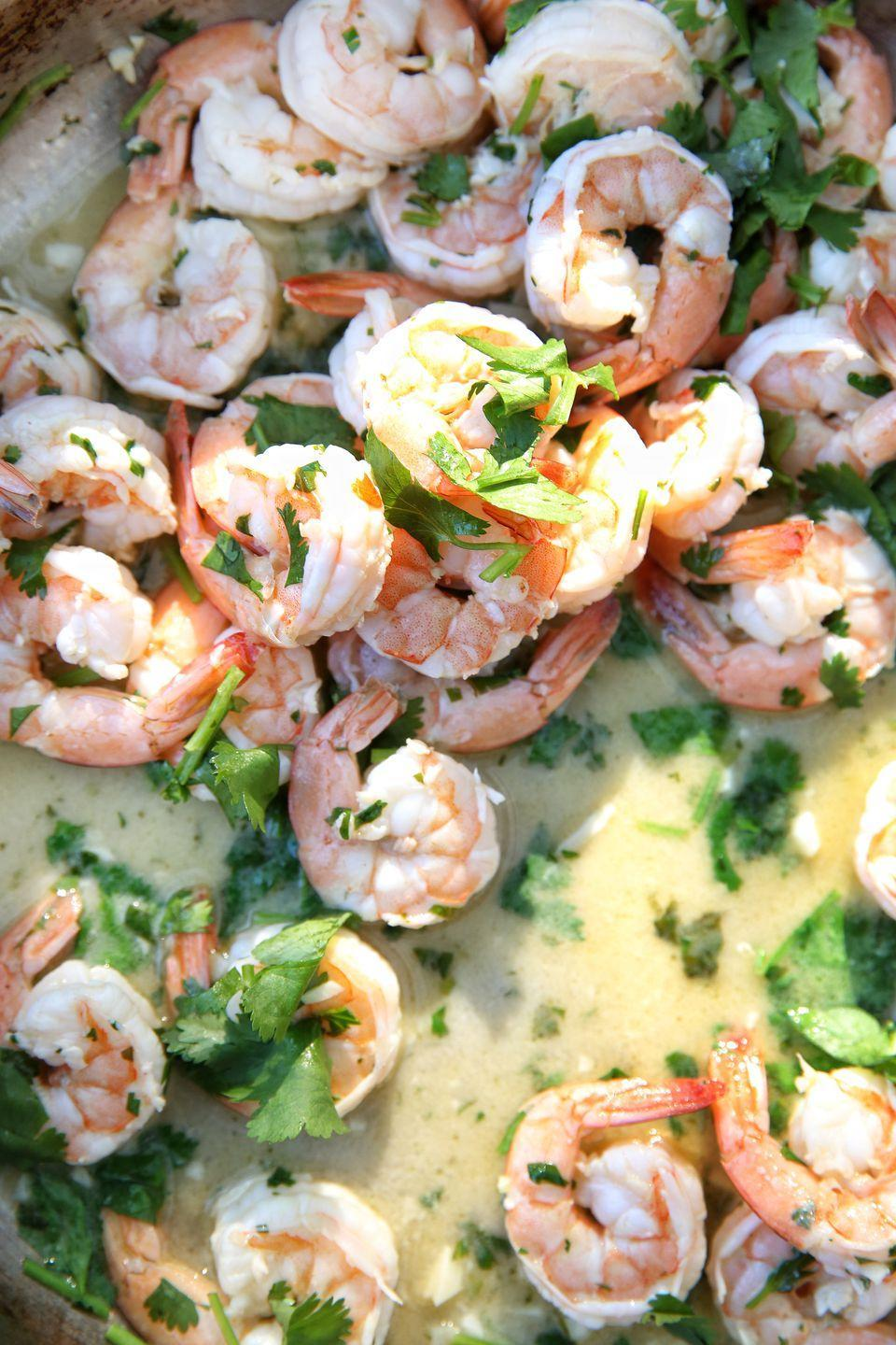 """<p>Shrimp tossed with fresh herbs and lime will wake up your taste buds.</p><p>Get the recipe from <a rel=""""nofollow noopener"""" href=""""https://www.delish.com/cooking/recipe-ideas/recipes/a49221/jerk-salmon-with-couscous-recipe/"""" target=""""_blank"""" data-ylk=""""slk:Delish"""" class=""""link rapid-noclick-resp"""">Delish</a>.</p>"""