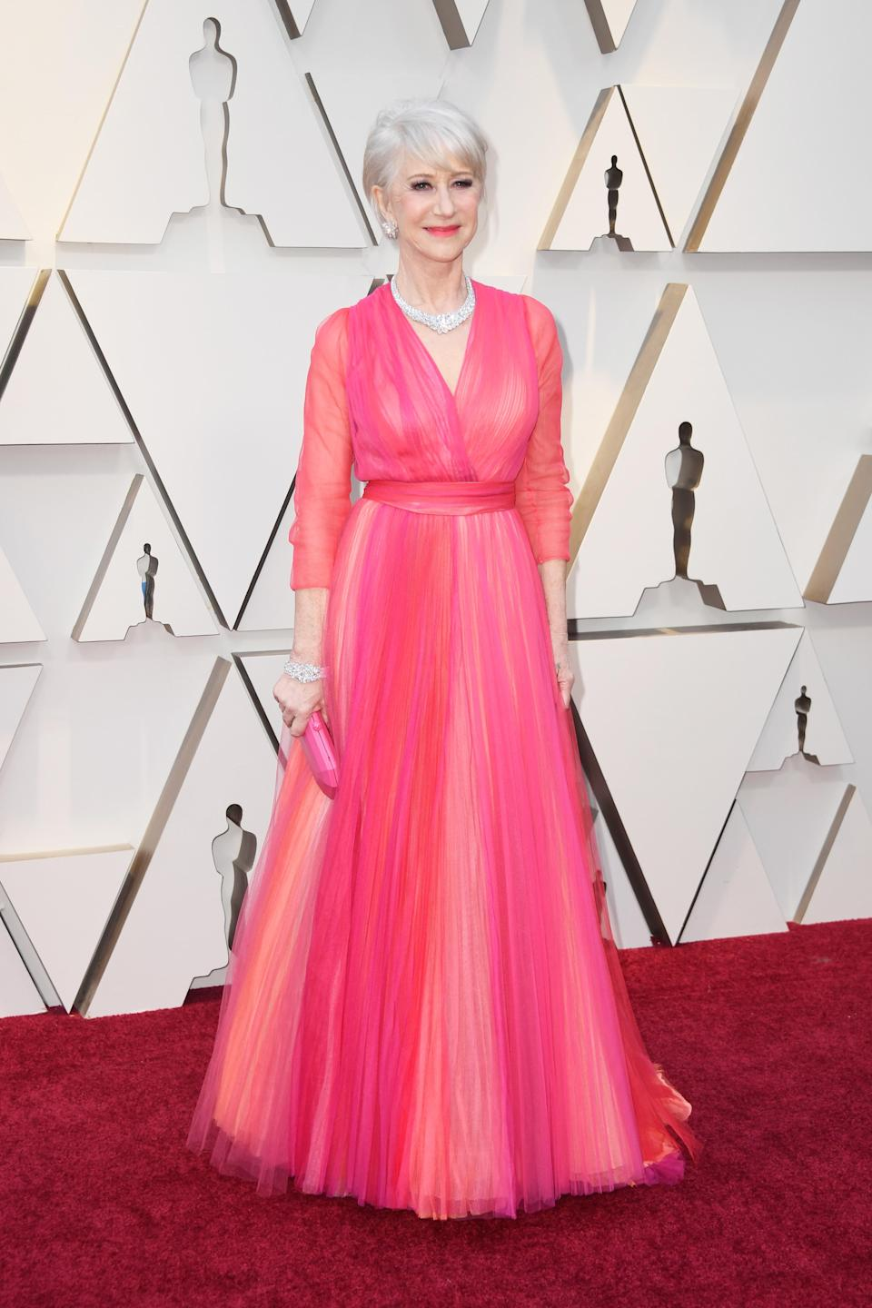 <p>The British actress wowed in a coral pink Schiaparelli Haute Couture dress, complete with three quarter length sleeves and an A-line skirt. <em>[Photo: Getty]</em> </p>