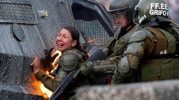 PHOTO: A riot police officer on fire reacts during a protest against Chile's government in Santiago, Chile, Nov. 4, 2019. (Jorge Silva/Reuters)